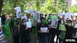 Iranian opposition supporters demonstrate outside the embassy in Yerevan on June 16.