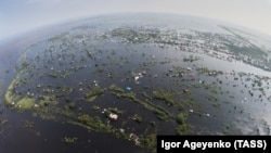 An aerial view of a flooded village in the Amur region in Russia's Far East on August 14