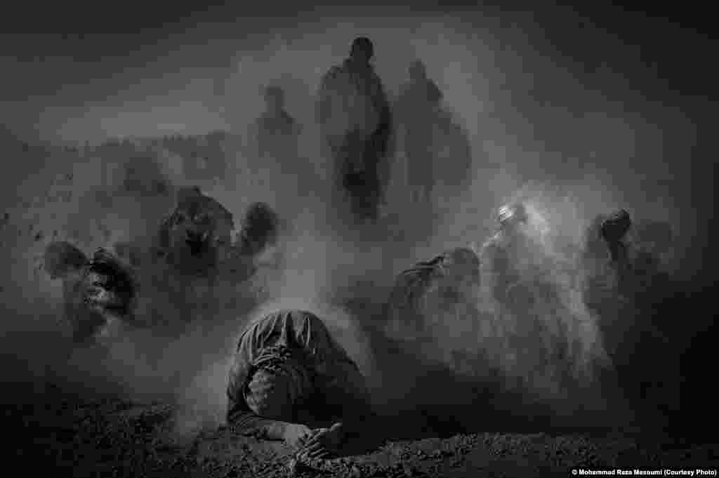 Mohammad Reza Masoumi of Iran took this photo of actors in a religious performance throwing dirt on themselves, signifying mourning.