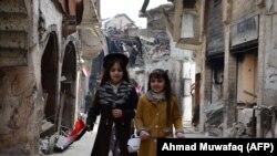 Зани олмониро дар инҷо дар шаҳри Мосул дастгир кардаанд.