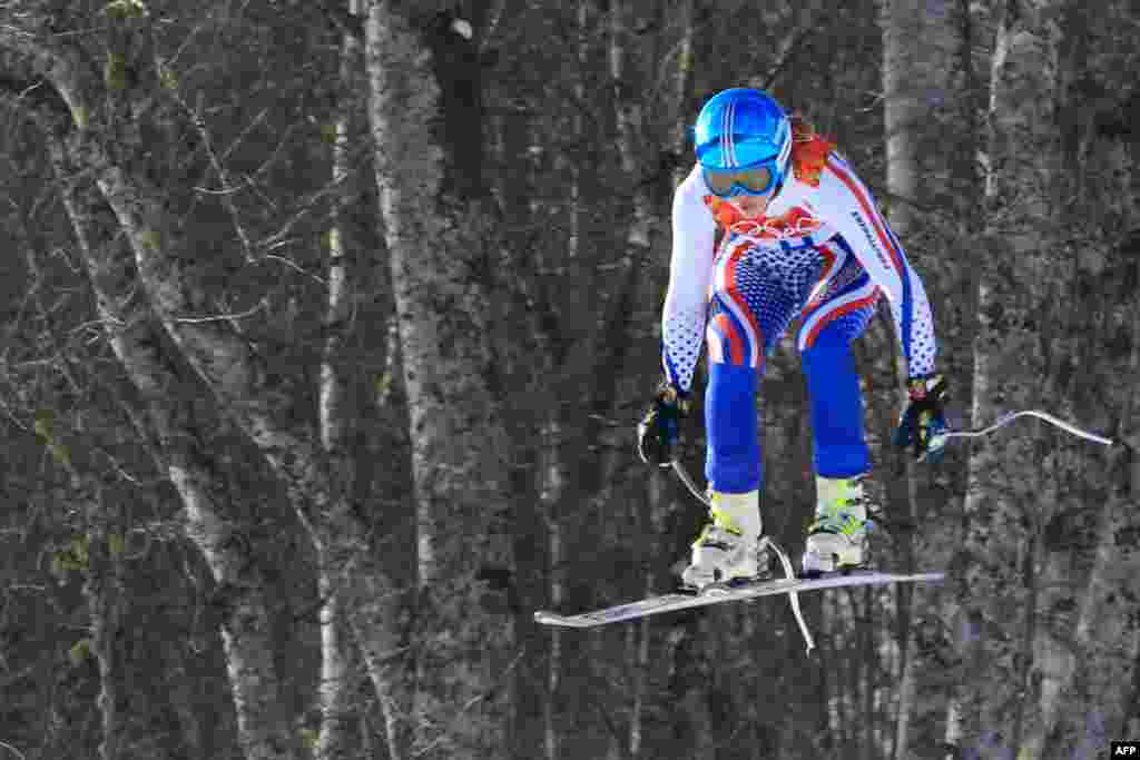 Russia's Yelena Yakovishina competes during the women's alpine-skiing super-combined downhill at the Rosa Khutor Alpine Center. She took 14th place in combined results.