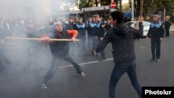 A clash between opposition activist Shant Harutiunian (left) and an unknown man in Yerevan during a march on November 5.