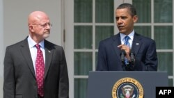 U.S. President Barack Obama (right) with national intelligence director nominee General James Clapper in Washington on June 5.