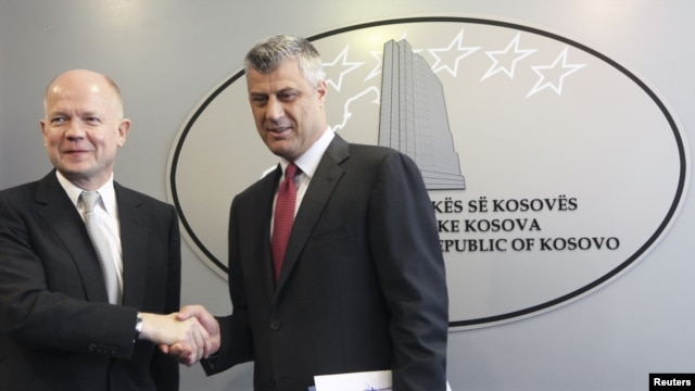 Kosovar Prime Minister Hashim Thaci (right) and British Foreign Secretary William Hague attend a news conference after their meeting in Pristina on October 25.
