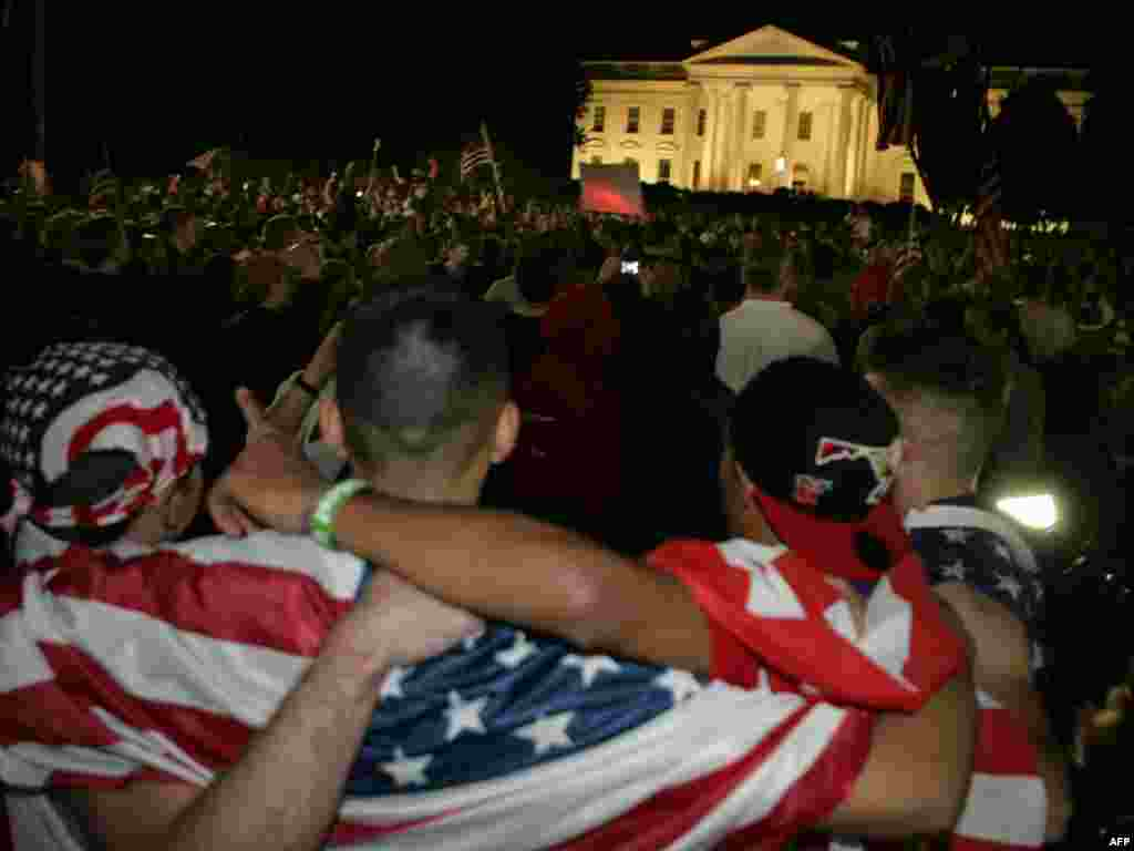 People celebrate outside the White House in Washington, D.C.