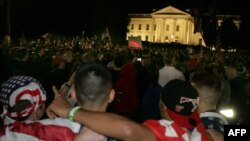 People celebrate the announcement of the death of Osama bin Laden at the White House in Washington.