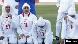Players for Iran's women's national soccer team react after the disqualification announcement in Amman, Jordan, on June 3.