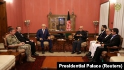Afghanistan's President Ashraf Ghani (Right) and U.S. special envoy for peace in Afghanistan, Zalmay Khalilzad, (Left) meet in Kabul, Afghanistan November 10, 2018. File photo