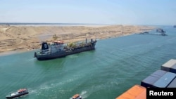 FILE - A cargo ship is seen crossing through the New Suez Canal, Ismailia, Egypt, in this July 25, 2015.