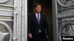 U.S. Ambassador to Russia Michael McFaul leaves the Foreign Ministry headquarters in Moscow. Analysts tell RFE/RL that he did well in his tenure during a difficult period in bilateral relations.