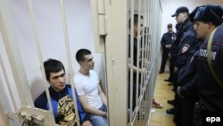 Defendants in the Bolotnaya case await their sentencing at a court hearing in Moscow on February 24.