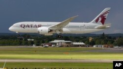 FILE- in this file photo dated Wednesday, July 11, 2012, onlookers watch as a Qatar Airways Boeing 787 Dreamliner lands during an aerial display at the Farnborough International Airshow, in Farnborough, England. The state-owned Commercial Aircraft Corp.