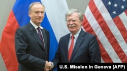 John Bolton (right), the U.S. national security adviser, shakes hands with his Russian counterpart, Nikolai Patrushev, during a meeting in Geneva on August 23.