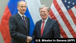 U.S. national-security adviser John Bolton (right) shakes hands with Russian counterpart Nikolai Patrushev during a meeting at the U.S. Mission in Geneva in August.