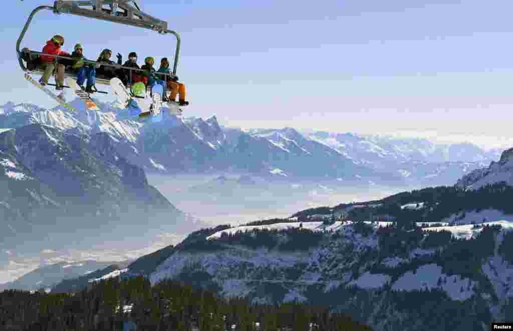 Skiers on a chairlift at the Flumserberg ski area in the Swiss Alps. (Reuters/Arnd Wiegmann)