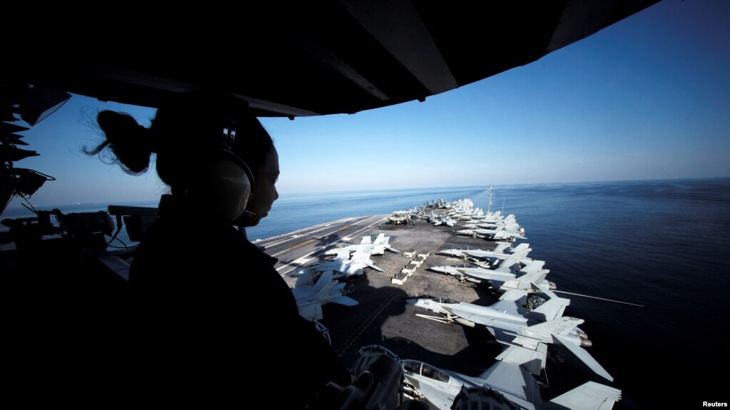 A U.S sailor keeps watch from the captain's bridge onboard the USS John C. Stennis as it makes its way to the Gulf through the Strait of Hormuz, December 21, 2018.