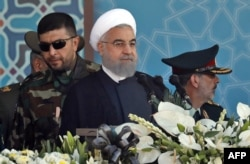 Iranian President Hassan Rohani as he delivers his speech during the annual military parade marking the anniversary of the outbreak of its 1980-1988 war with Iraq.