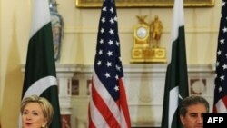 U.S. Secretary of State Hillary Clinton and Pakistani Foreign Minister Shah Mehmood Qureshi at the State Department in Washington on March 24.
