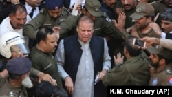Pakistani former Prime Minister Nawaz Sharif arrives at a court in Lahore on October 11.