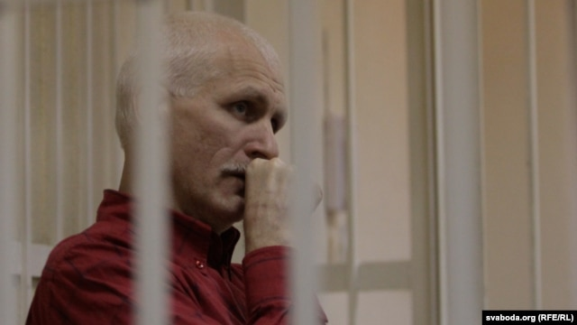 Ales Byalyatski sits in a Minsk court during his trial in November 2011.