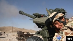 FILE: An Australian gunner fires his 105mm Light Gun at Taliban positions in Kajaki, Helmand province in 2008.