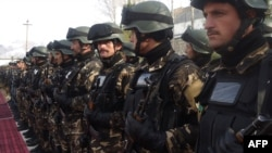 Afghan security forces stand during a ceremony to hand over security control in Badakhshan province, Faisabad, in January 2012.