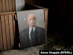 A portrait of Lenin inside the derelict tea factory.