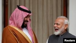 Saudi Arabia's Crown Prince Mohammed bin Salman and India's Prime Minister Narendra Modi react ahead of their meeting at Hyderabad House in New Delhi, India, February 20, 2019. REUTERS/Adnan Abidi