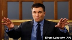 "Ukrainian Foreign Minister Pavlo Klimkin stayed away, writing on Facebook that ending sanctions will start the process of ""normalizing"" everything Russia has done."