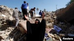 A woman reacts at the site of a suicide bomb attack on Shi'ite mosque in Mussayab, south of Baghdad, on September 30.