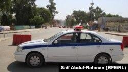 دورية شرطة تفرض إجراءات أمنية في الكوت