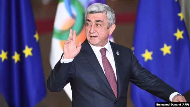 Armenian President Serzh Sarkisian arrives for an EU Eastern Partnership summit with six eastern partner countries at the European Council in Brussels on November 24.