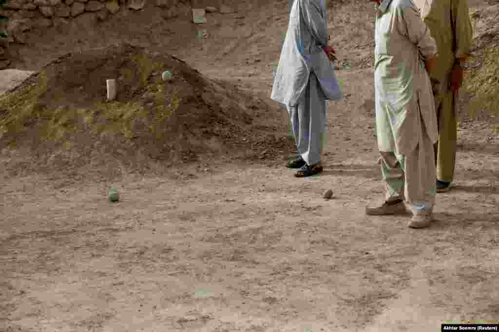 The traditional Hazara game involves two teams taking turns hurling stones at a beer can-sized target. The first team to hit the target 10 times wins.