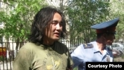 Kazakh opposition activist Aidos Sadyqov is arrested in Aqtobe in July 2010.