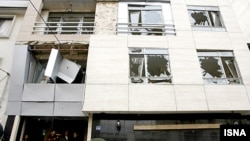 Shattered windows at the scene of the January 12 bombing