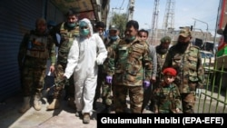 Afghan National Army personnel spray disinfectant during a lockdown in Jalalabad on April 9.