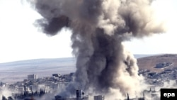 Smoke rises above the west of Kobani after a suspected U.S. air strike on October 8.