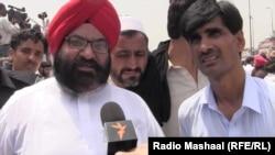 Sardan Soran Singh (left) being interviewed by Radio Mashaal. (file photo)