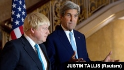 British Foreign Secretary Boris Johnson (left) and U.S. Secretary of State John Kerry in London on October 16