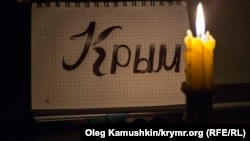 Ukraine, Crimea - A burning candle, 04Dec2014