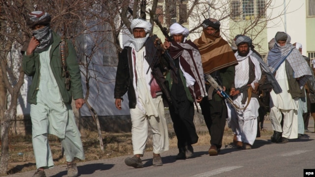 Taliban militants surrender at an amnesty ceremony in Herat, in western Afghanistan, in January 2012.