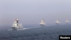 Chinese missile destroyers navigate during a joint China-Russia naval exercise in the Yellow Sea in April 2012.