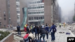 Последствия взрыва у здания правительства Норвегии. Осло, 22 июля 2011 г