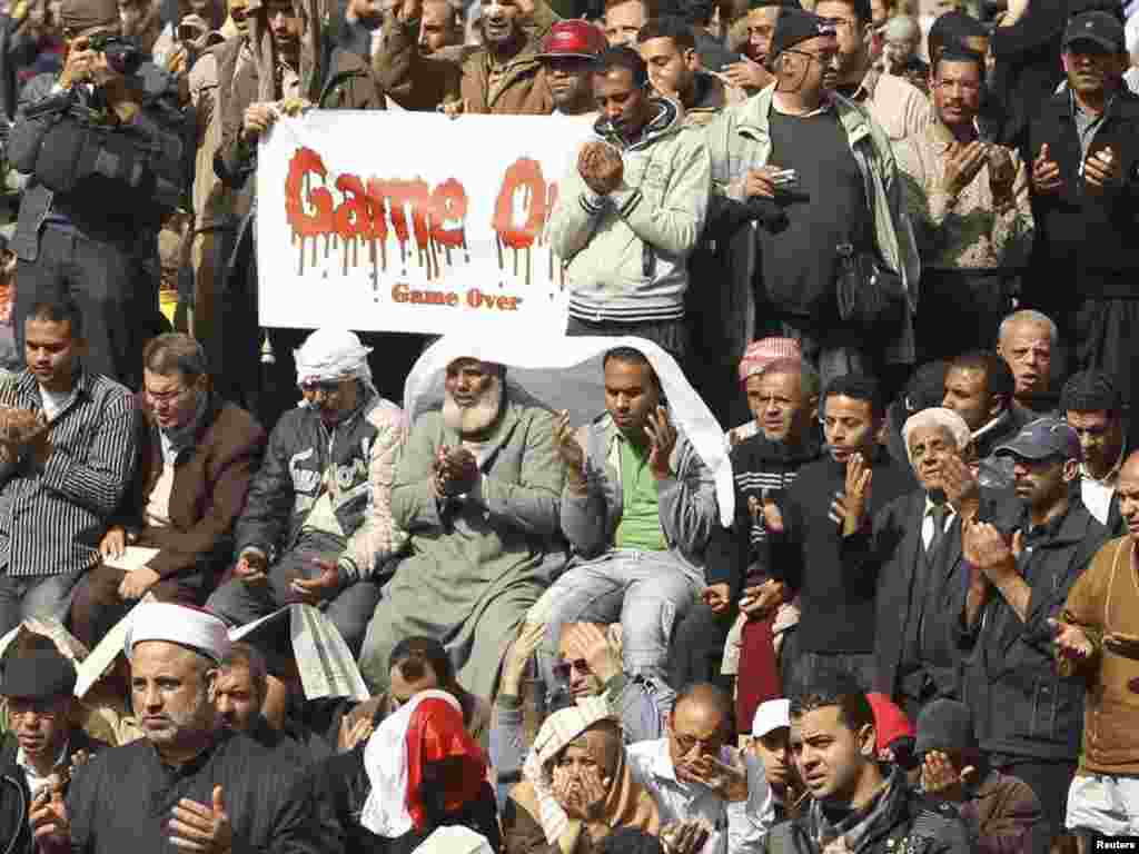 Opposition supporters attend Friday Prayers on Tahrir Square in Cairo.
