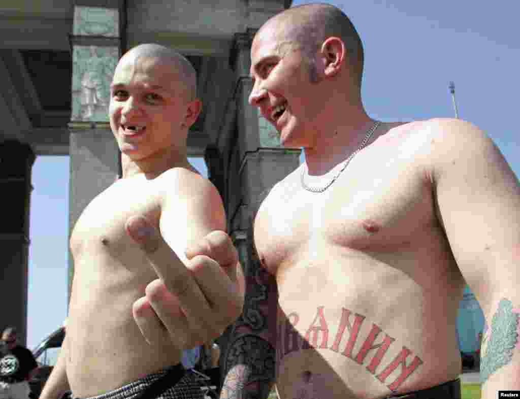 "Then things changed. In 2006, under the presidency of Vladimir Putin, the small city of Ryazan imposed a ban on ""homosexual propaganda."" Gessen says it was ""the first law in Russia that actually enshrined second-class citizenship [for LGBT people]."" This picture shows skinheads in Moscow preparing to confront a planned gay-rights parade in 2007."