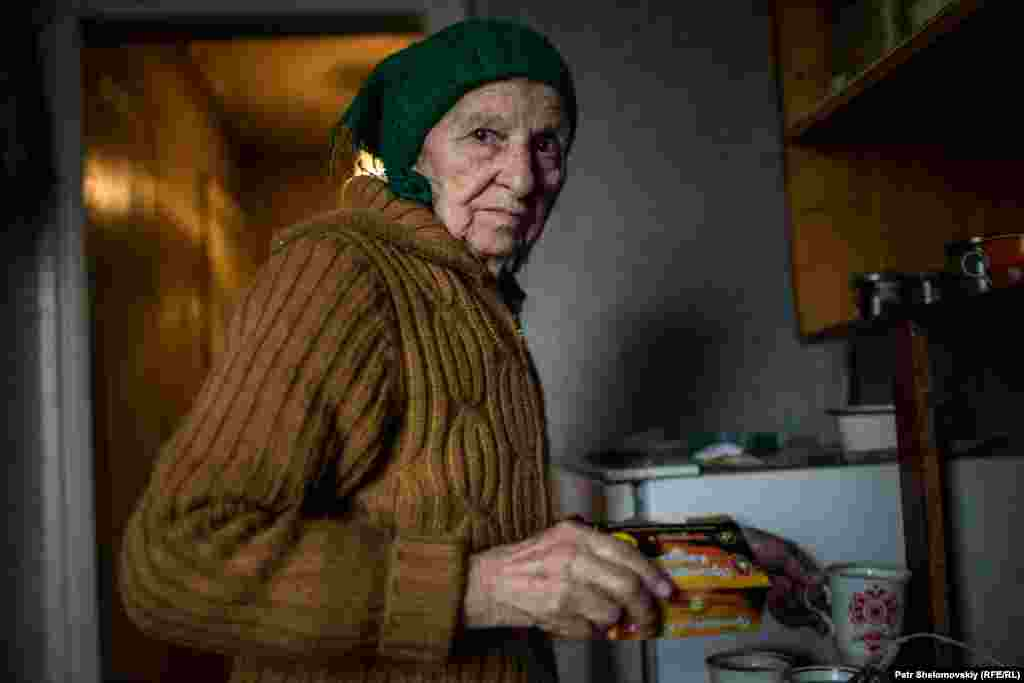Raisa Kozakova, 84, shared her apartment for a time with eight people in need of housing. The others have now returned to their own homes.
