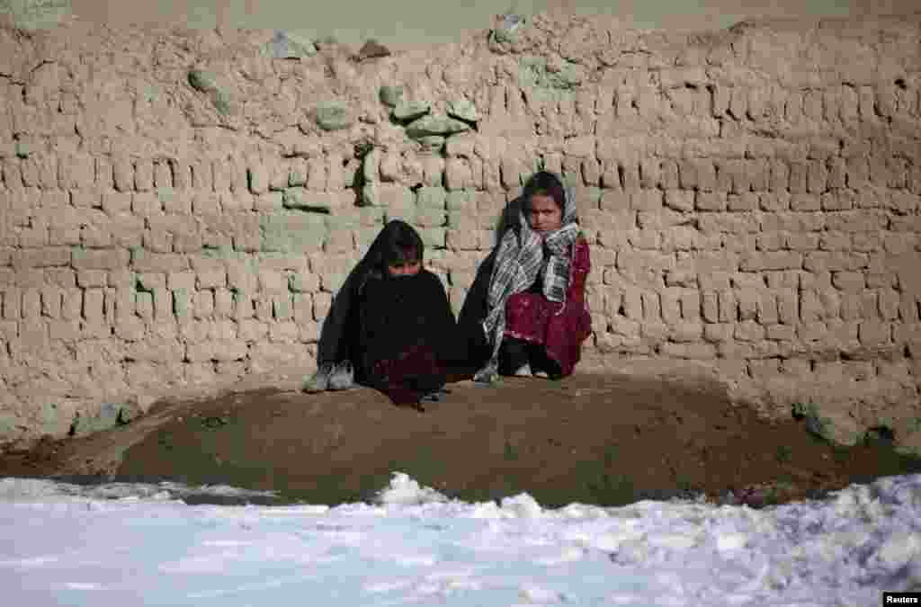 Afghan girls wait for treatment at the Mobile Clinic, provided by Afghan Family Guidance Association, on the outskirts of Kabul. (Reuters/Mohammad Ismail)