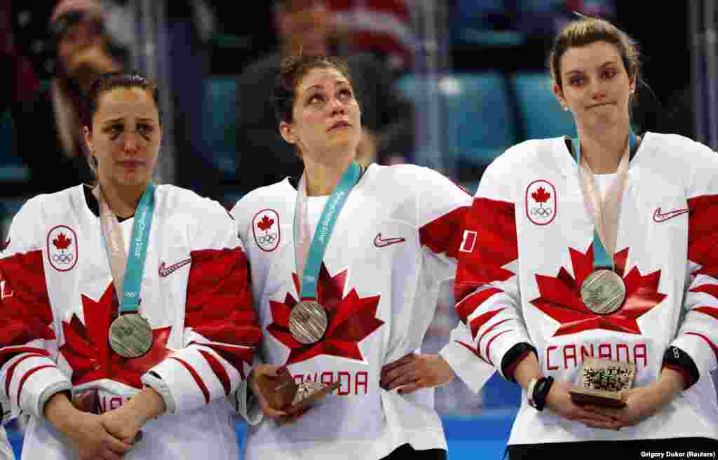 Ice Hockey: Canadian players react in dejection with their silver medals after Women's Gold Medal Final Match against the team of U.S. at Gangneung Hockey Centre during the Pyeongchang 2018 Winter Olympics, Gangneung, South Korea, February 22, 2018.