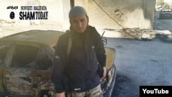 A screen grab from a video purportedly showing a Chechen militant in Syria exhorting his compatriots to join Islamic State.