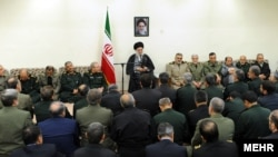Iranian Supreme Leader Ayatollah Khamenei (center) speaks to armed forces commanders in April.